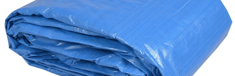 Rolled blue heavy duty tarps