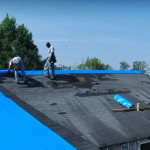 Installing roof tarps during renovation.